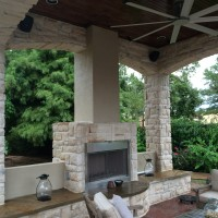 Outdoor Sitting Area in Houston Gets Fireplace Warm-up