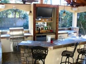 Outdoor Living Space With TV and Bar