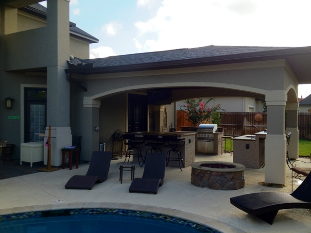 Beautiful stucco arches to match the house for Stucco patio cover designs