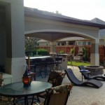 This outdoor living space, complete with covered patio, outdoor kitchen, wet bar, grill area, Kegerator and firepit, was designed by Outdoor Homescapes of Houston in Cypress, TX. For more ideas and inspiration, visit www.outdoorhomescapes.com