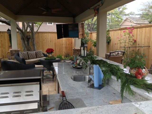 This Covered Patio Features An Outdoor Kitchen With A Sink State Of The Art Grills