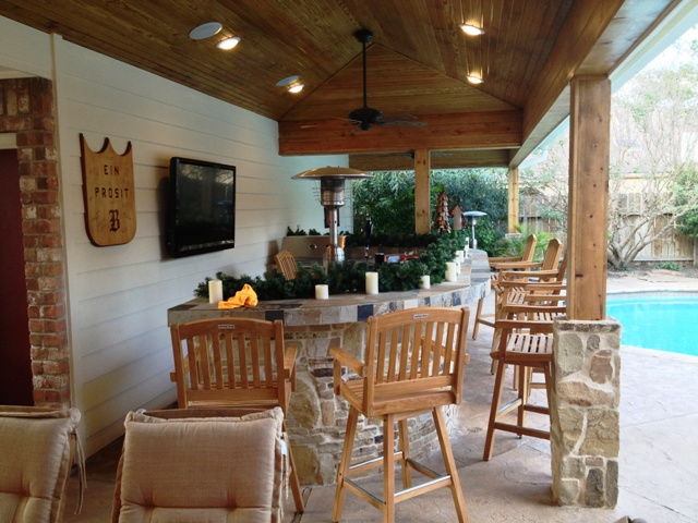 Outdoor decorating ideas include changing it up for each season, as these homeowners did with evergreen boughs and candles in winter, says Lisha Maxey, senior designer with Outdoor Homescapes of Houston. More outdoor decor ideas for your patio or outdoor living space by this Houston outdoor living space designer at www.outdoorhomescapes.com
