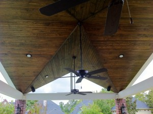 This patio cover by Outdoor Homescapes of Houston is a roof extension done in a double A or double gable construction. For more patio covers, outdoor kitchens and outdoor living spaces, go to www.outdoorhomescapes.com.