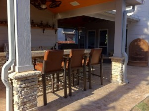 """After shot"" of an outdoor living space design by Outdoor Homescapes of Houston. This angle showed the covered patio housing an outdoor bar and grill area. More at www.outdoorhomescapes.com"