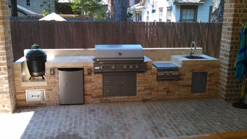 This outdoor kitchen by Outdoor Homescapes of Houston features (from left) a Big Green Egg grill, an RCS outdoor refrigerator, an RCS grill, an RCS side burner and an outdoor sink. More at www.outdoorhomescapes.com/blog