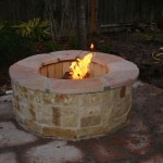 This fire pit is one of the many designed and built by Outdoor Homescapes of Houston, an outdoor living space designer specializing in outdoor kitchens, patios and covered patios, fire pits, water features, stamped or designer concrete, pergolas, arbors, mosquito and lighting systems, outdoor media systems, bar and grill areas and more. More at www.outdoorhomescapes.com
