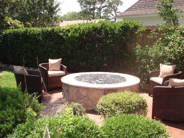 Even though Houston fire pits typically beckon a crowd, they also provide an ideal get-away in a world of distractions, worries and obligations. This intimate setting, designed and built by Outdoor Homescapes of Houston, with a fire in the middle, creates a focal point, a sense of calm and an infusion of energy. More at www.outdoorhomescapes.com