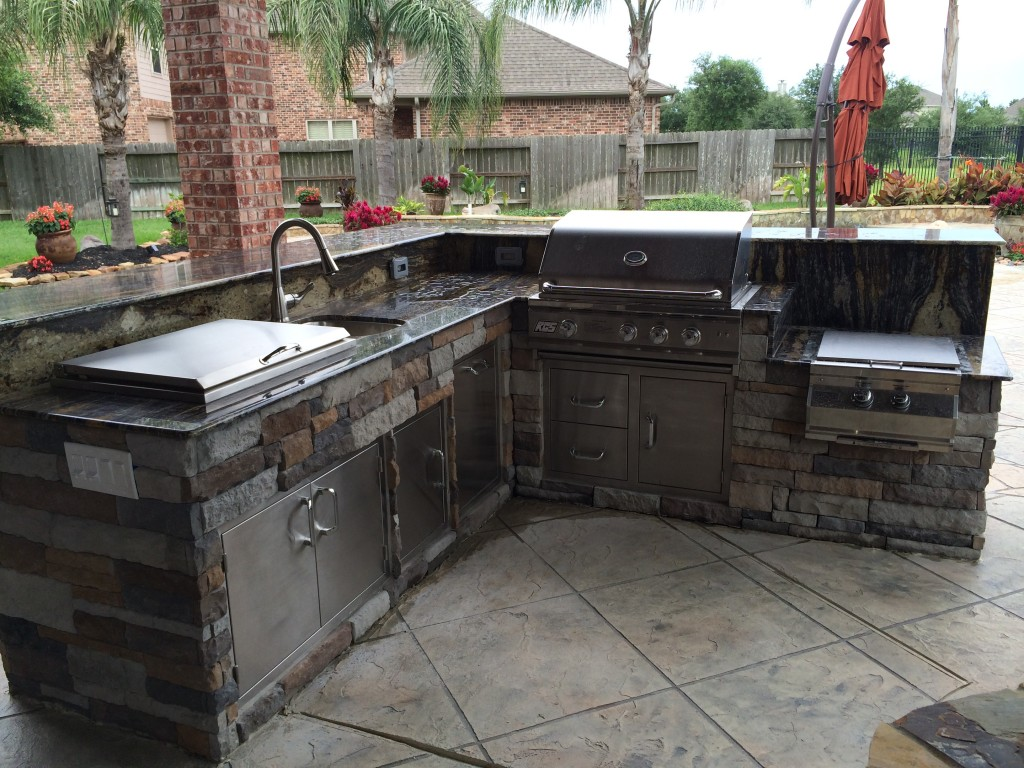 This outdoor kitchen by Outdoor Homescapes of Houston features RCS appliances and stainless steel storage: a drop-in cooler, 30-inch grill, power burner and sink. More at www.outdoorhomescapes.com/blog