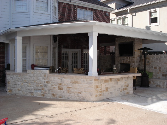 This 400-square-foot covered patio in Houston is perfect for watching football on TV outside. More at www.outdoorhomescapes.com
