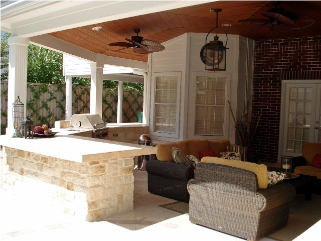 Houston patio covers like this one by Outdoor Homescapes of Houston offer the ideal spot for watching football on TV outside in fall. More at www.outdoorhomescapes.com