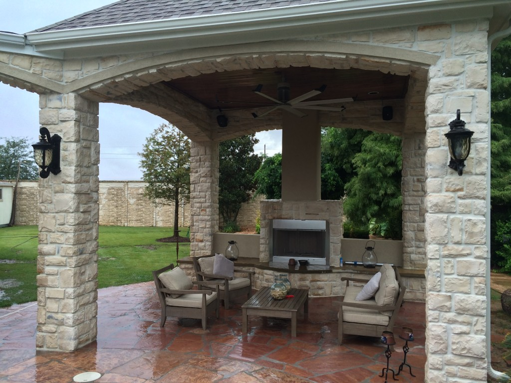 This Houston outdoor sitting area gets warmed up in the cool season with this gas fireplace. This Houston covered patio addition was designed and built by Outdoor Homescapes of Houston. More at www.outdoorhomescapes.com.