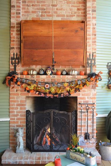 Looking for Halloween patio decorating ideas in 2014? How about this Rumford fireplace decked out with gothic candlestick decorations, metallic pumpkins and playful banners? This Houzz ideabook is one of the Halloween outdoor living space decor ideas shared by Outdoor Homescapes of Houston on its blog. More at www.outdoorhomescapes.com