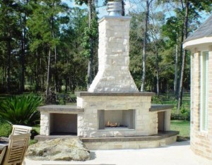 Outdoor fireplaces like this one are among the outdoor heating options offered by Outdoor Homescapes of Houston. More at www.outdoorhomescapes.com.