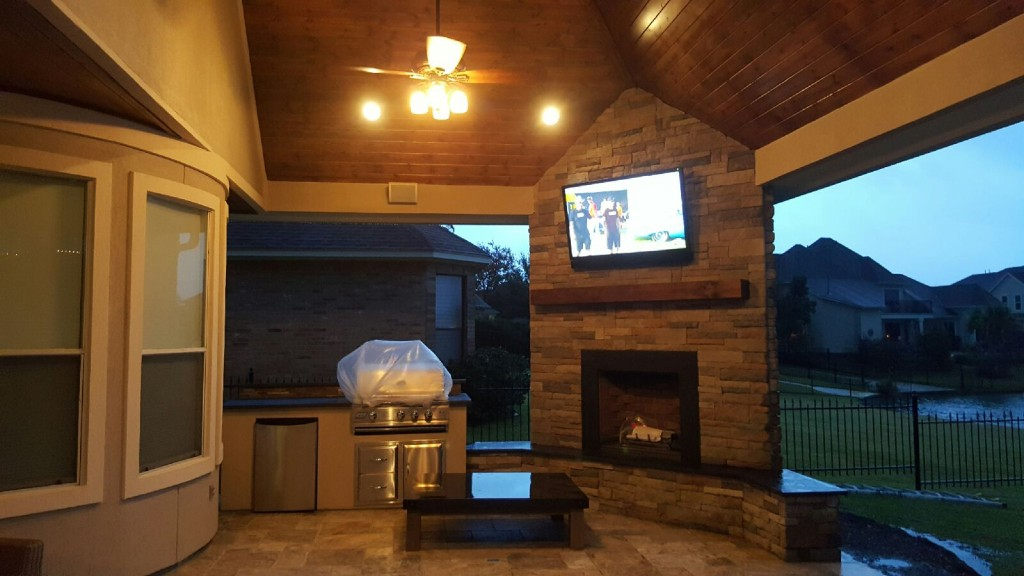 This Houston Patio Addition By Outdoor Homescapes Of Houston Features An  Outdoor Kitchen, Corner Fireplace