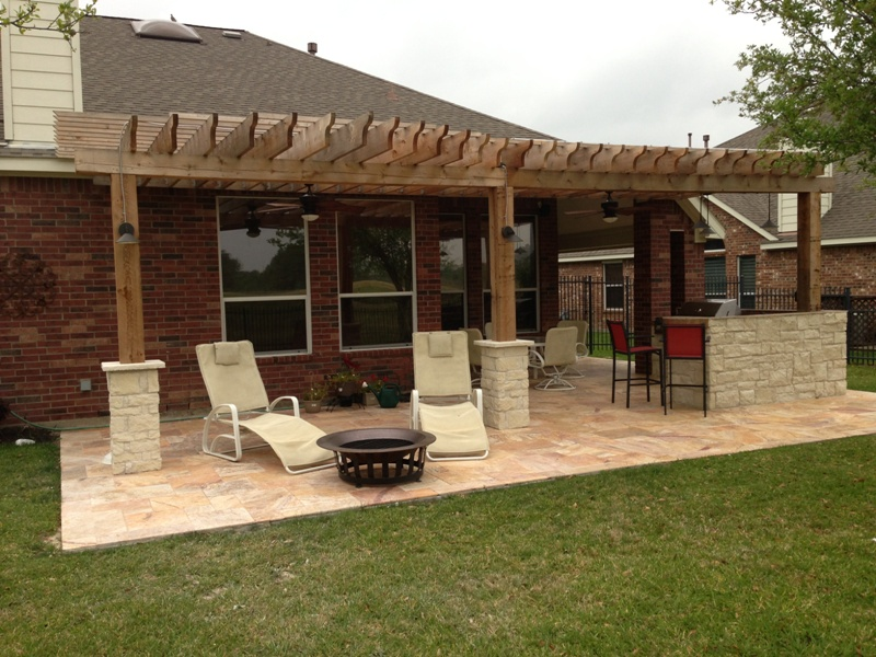This Houston patio addition by Outdoor Homescapes of Houston is about 450 square feet with a double pergola and outdoor kitchen. More at www.outdoorhomescapes.com/blog