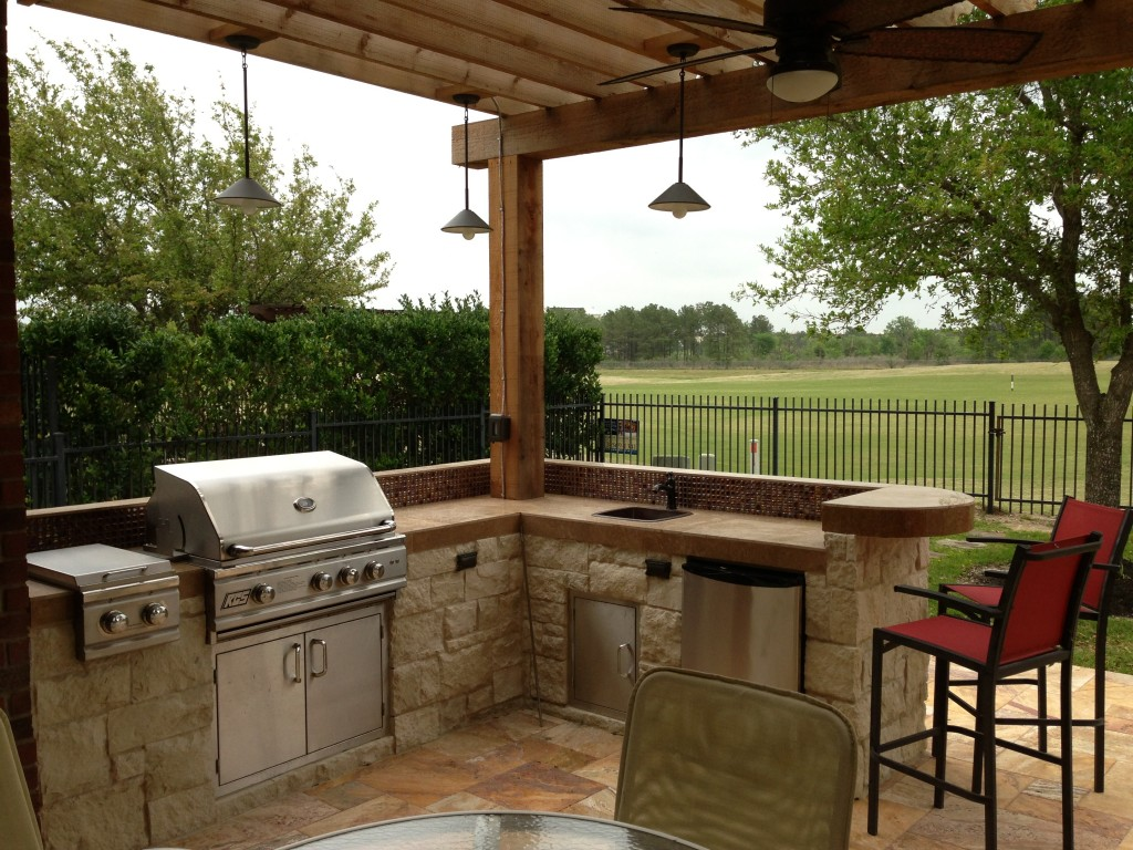 This Houston patio addition by Outdoor Homescapes of Houston features an outdoor kitchen faced in  Austin limestone dry-stacked in a castle pattern. The components are an RCS 30-inch grill, double burner and outdoor refrigerator. The flooring is Fantastico travertine and the countertop is English walnut travertine. More at www.outdoorhomescapes.com/blog