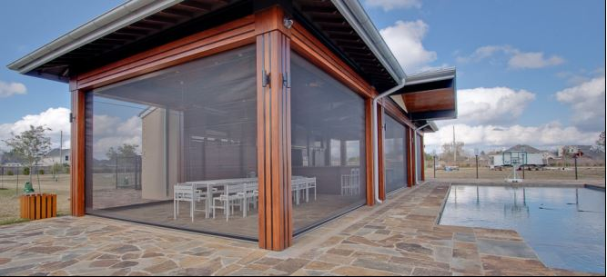 Retractable patio screens like this one - the Executive Screen by Phantom Screens - are offered by Outdoor Homescapes of Houston. More at www.outdoorhomescapes.com/retractable-patio-screens