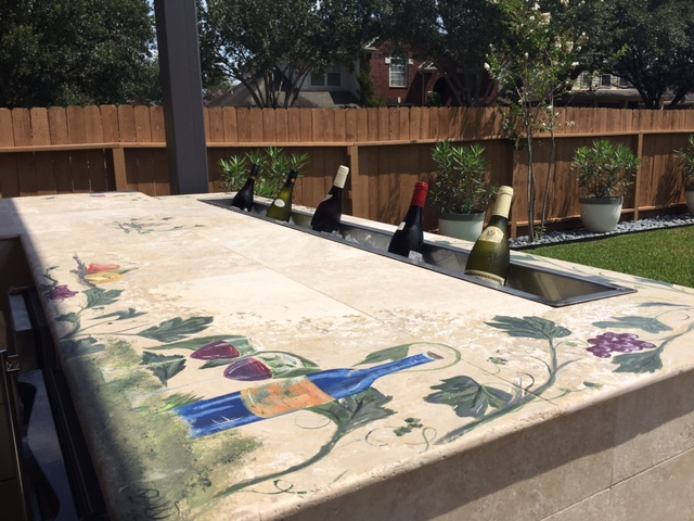 "This unique Houston covered patio addition includes painted Tuscan details on a concrete counter, plus a ""wine trough."" More details at www.outdoorhomescapes.com/blog"
