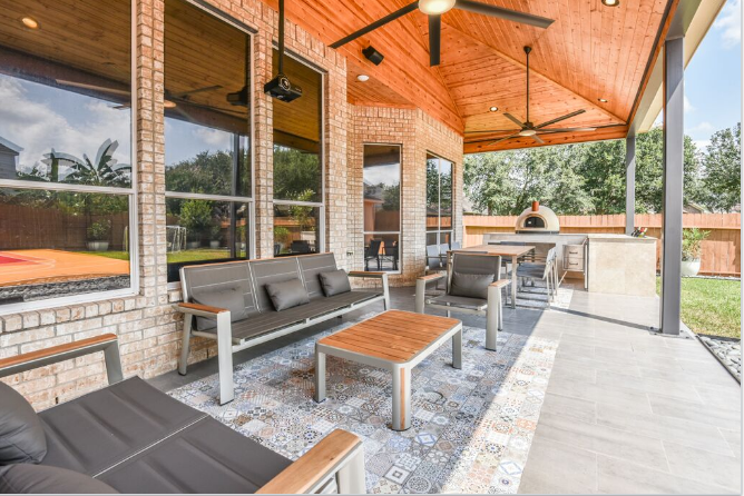 "This unique Houston patio features a colorful, detailed-tile ""area rug,"" a ""wine trough"", minimalist furniture and a basketball court! More info at www.outdoorhomescapes.com/blog"