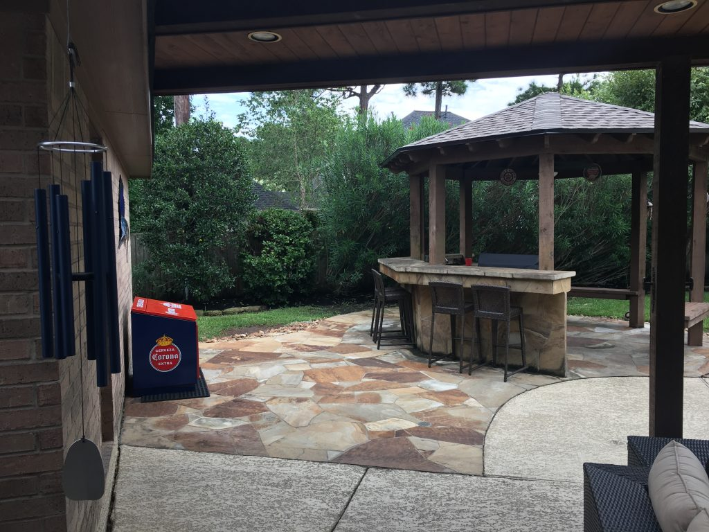 A large covered patio with an 800-square-foot roof extension replaced this small, not-so-waterproof pavilion where a Spring, TX often entertained friends and family. More on Homescapes of Houston's blog, at www.outdoorhomescapes.com/blog